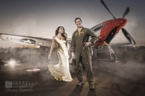 Air Force engagement photo with P-51 for Grand Island Wedding